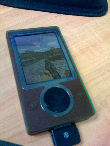 During the launch of Microsoft's Zune product line back in 2006, Microsoft had approached Valve Software to port Half-Life to the Zune in attempt help move units. Valve agreed and a port was created, however there were several major setbacks with the port. These setbacks range from the HUD not working as intended to a crash occurring on any map that has more than 4 headcrabs spawned in.   Valve and Microsoft ultimately canned the port and settled on that the next new Valve game would be a console exclusive to the XBox 360. This is why Left 4 Dead never released for the Sony PlayStation 3.