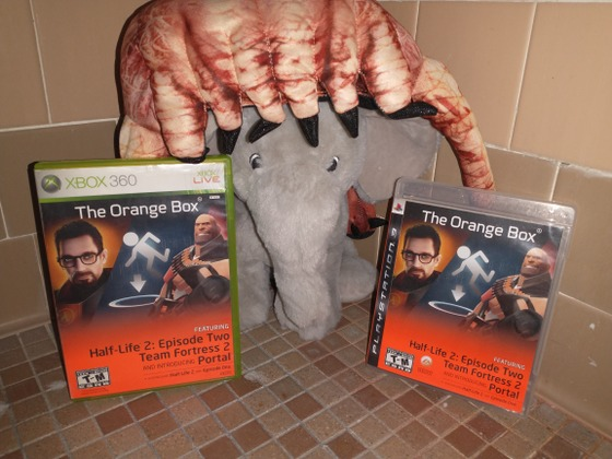 """Man, to think The Orange Box is now 14 years old. That is a happy birthday to Half-life 2: Episode 2, Portal and Team Fortress 2. My copy on the right is 12 years old when I got it on Christmas Day of 2009. The PS3 port I got this year.  The PlayStation 3 port is a poor and bad attempt of The Orange Box. Since Gabe Newell had a grudge with PlayStation, Valve just got EA to port it instead. It was something like that, I read some funny quotes from Gabe Newell and how much he hated the PlayStation 3.  Now, most people seem to forget about how Valve and EA once partnered at one point in time. I was one of those people, I kind of just pretend that it didn't happen. But then I look at the PlayStation 3 port and I always say to myself, """"Oh yeah... that ummm... actually happened.""""   Think about that for a minute: EA HAS THEIR NAME ON A HALF-LIFE GAME! That is crazy man."""